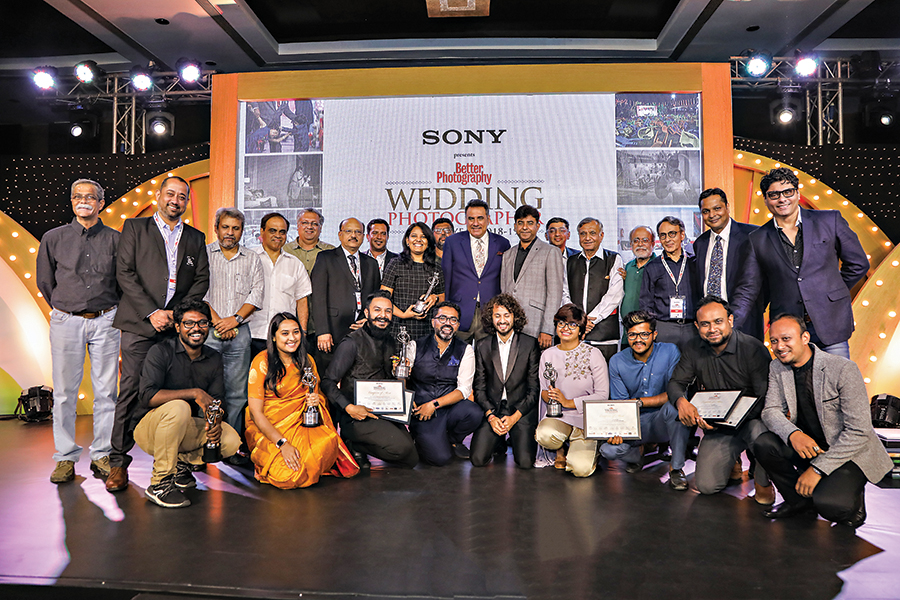 Group photograph with our partners, guests, as well as the winners of the eighth edition of the Sony Better Photography Wedding Photographer of the Year 2018-19 Awards. Top row (from left to right): Milind Ketkar, Mukul Kashyap, Fawzan Husain, Guru Dutt, Madhur Shroff, Jayesh Mehta, Appadurai A, Prasheila Lookhar, Indranil Mukherjee, Boman Irani, Prakash Tilokani, Amit Seth, Hari Mahidhar, Swapan Mukherjee, Dhaval Soni, K Madhavan Pillai & Riyaz Gang ji. Bottom row (from left to right): Pon Prabakaran, Rishika Brahma, Abhimanyu Sharma, Joseph Radhik, Divyam Mehrotra, Harsheen Jammu, Sandeep Holla, Sanoj Kumar & Gautam Agarwal.