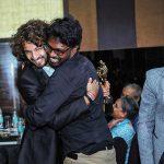 After his win, Divyam Ramji Mehrotra hugs Pon Prabakaran.