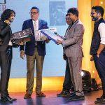 Divyam Mehrotra receives his prizes from Boman Irani, Prakash Tilokani & Joseph Radhik.