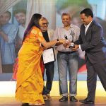 Rishika Brahma, Winner, Family & Friends category, receives her award from Atul Loke, Fawzan Husain and Appadurai A.
