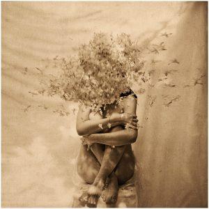 Fine art monochrome portrait of woman with mogra flowers